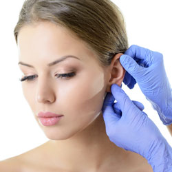 Female model's ear being examined