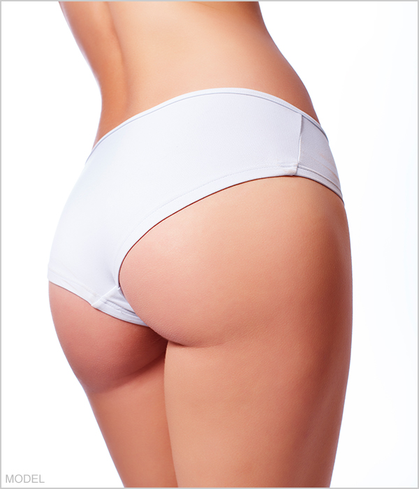 Brazilian butt lift model in white shorts
