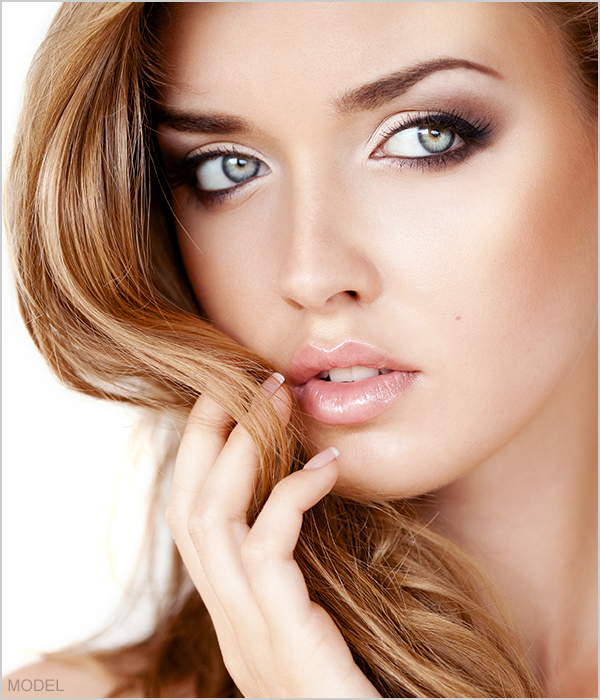 Face of blonde model with hazel eyes